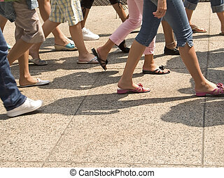 In Step - This is a shot of lots of legs walking in the city...