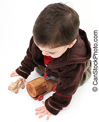 Child Boy Toys - Toddler boy on floor playing with old...