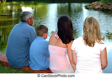 Family of Four Looking at Pond - Family of four looking out...