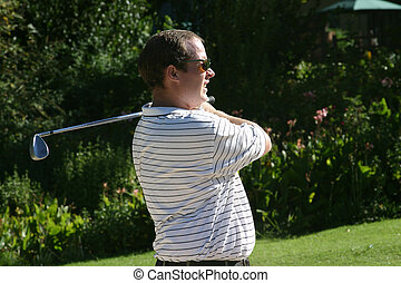 staring golfer - looking at his shot