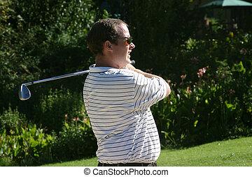 staring golfer - looking at his shot