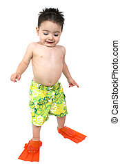 Boy Child Swim - Toddler boy in swimsuit and flippers over...