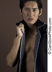 Muscular 8 - A muscular asian model in a black waistcoat