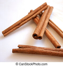 Cinnamon sticks on a cutting board, aesthetically arranged.