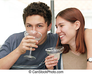 Cheers! - 2 teenagers drinking margarita