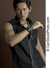 Male Model 2 - A muscular asian male model in a black...