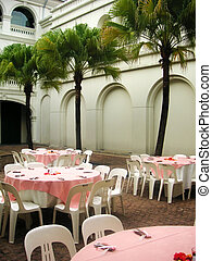 Al fresco dining in the courtyard, with palm trees