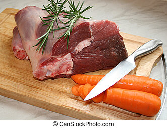 Lamb - A joint of lamb ready for cooking,with carrots and...