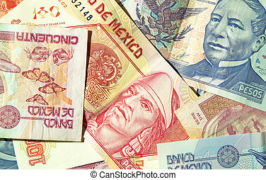 Mexican Pesos - Various denominations of pesos, money from...