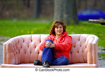 Relaxing Outdoors - Woman Relaxing On a Old Sofa Outdoors.