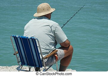 Man Fishing - Photographed a man fishing from a jetty in...