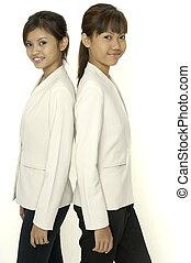 Two Young Women - Two young pretty asian women in matching...