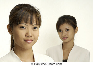 Young Businesswomen - Two young businesswomen from asia