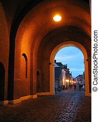 city gate in Dutch town at sundown