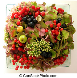 autumn arrangement of flowers and fruits