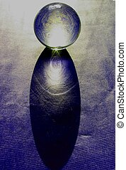crystal ball on blue paper