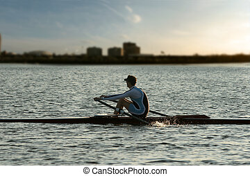 Rowing alone at sunset