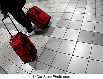 Airport - Man with red bags at the airport