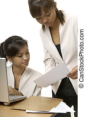 Working On Laptop 6 - Two asian businesswomen discuss a...
