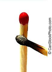 Burnt and unburnt - A burnt and unburnt match isolated on a...