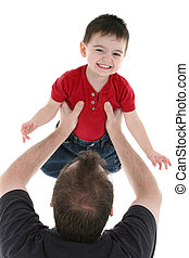 Father Son Family - Father and son playing airplane over a...