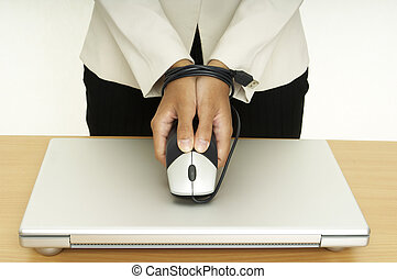 Bound By Technology 5 - A woman holds a mouse over a laptop...