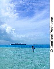 Girl Walking in Lagoon