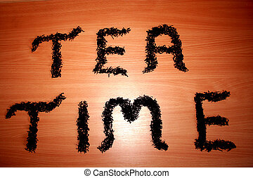 Tea Time - Digital photo of black tea, decorated in letters.