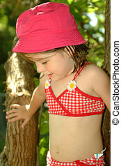 Children-Summertime Cutie - Little girl wearing a swimsuit,...