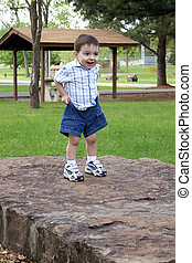 Boy Child Park Play - Small boy standing on large rock...