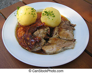 Roast Pork - A rich serving of roast pork with potato...