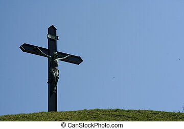 Jesus on hilltop - A cross with jesus at a hiltop.