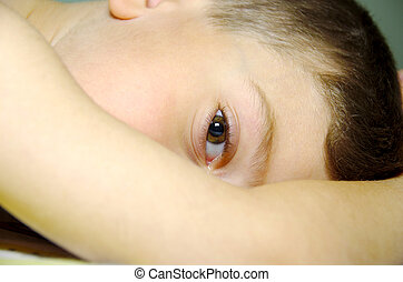 Childs Eye - Young Child Laying Down With Focus on Eye