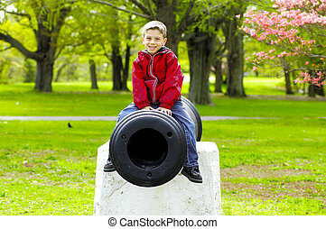 Child Sitting on Cannon
