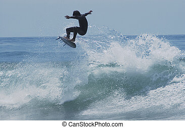 Flying Surfer - Sufer catapulting out of wave