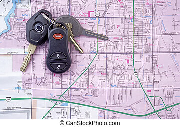 Map and Car Keys 2 - A set of car keys rests on a street map...