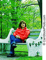 Woman on a Bench 3 - Woman Sitting on a Park Bench.