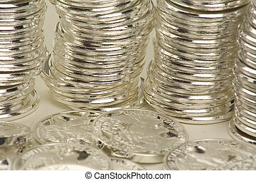 coins stacked - silver coins stacked in rows