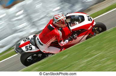 Motorbike Racing - A motorbike racing in circuit, visible...