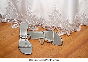 Wedding Day - A wedding dress and a pair of shoes