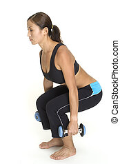 Squat 1 - A female fitness instructor demonstrates the...