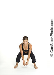 Jump Squat 3 - A female fitness instructor demonstrates the...