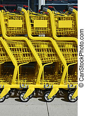 Shooping Carts - Yellow shopping carts at a Supermarket