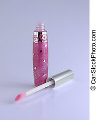 Lip Gloss - An open bottle of lip gloss