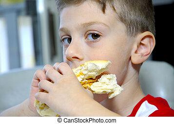 Boy Eating Sandwich - Young Boy Eating a Sandwich