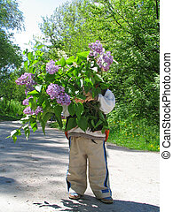 Lilac for mum - Child carries the big bouquet of a lilac to...