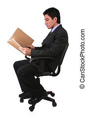 business documents - Latin businessman reading papers and...