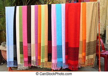 Silk scarves - row of colorful silk scarves on display