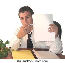 Young Executive At Desk - Young man at desk holding up blank...