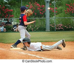 Safe - Baseball runner sliding into plate